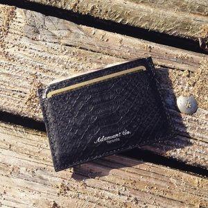 Black genuine snake skin card holder.